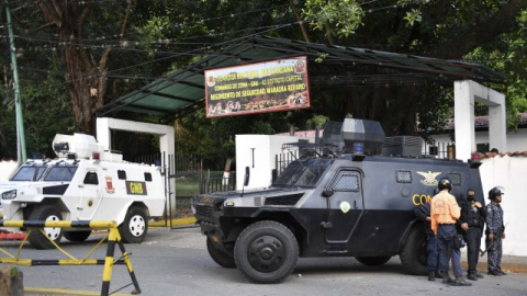 Armoured vehicles of the Bolivarian National Guard (GNB) and the National Anti-Extortion and Anti-Kidnapping Special Forces (CONAS) outside the San Jose de Cotiza Barracks in Caracas Monday